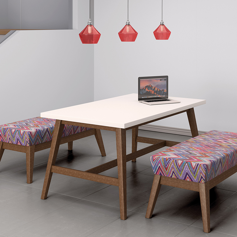 Patterned bench seating and a white wooden table