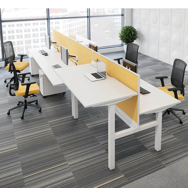 A row of white sit-stand desks and black and yellow chairs