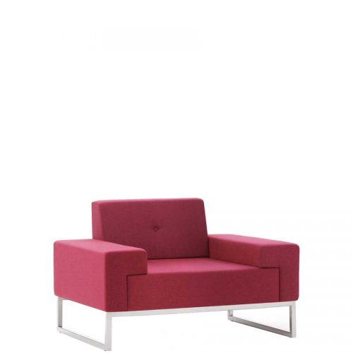 Low armchair upholstered in red