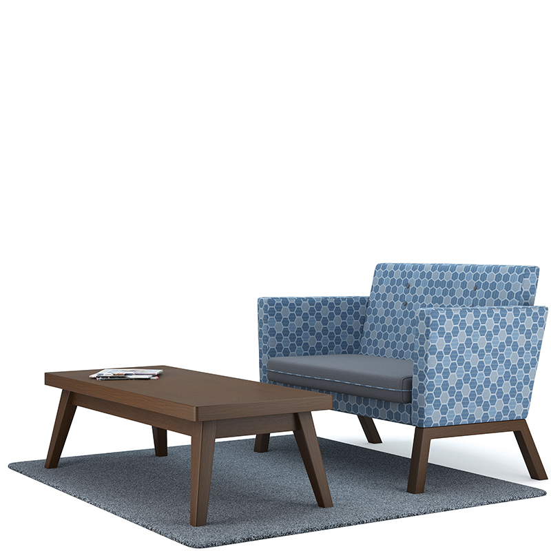 Dark wooden rectangular table with blue geometric patterned sofa